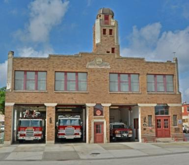 Station 14, down town, mango street, bay doors open with 3 fire trucks inside